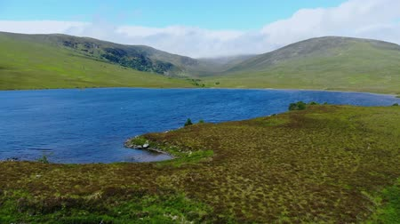 geologia : Beautiful blue lakes in the Highlands of Scotland - aerial drone flight Wideo