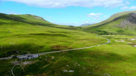 awesome : Flight over the awesome landscape of Glencoe in the Highlands of Scotland Stock Footage