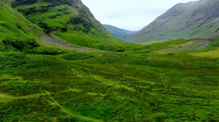 高地 : Flight over the awesome landscape of Glencoe in the Highlands of Scotland 動画素材