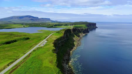 lakes of scotland : Flight over the green coastline and cliffs on the Isle of Skye in Scotland