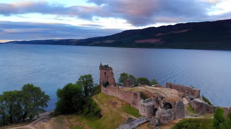 lakes of scotland : Loch Ness and Urquhart Castle in the evening - aerial drone footage