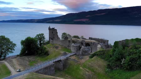geologia : Loch Ness and Urquhart Castle in the evening - aerial drone footage