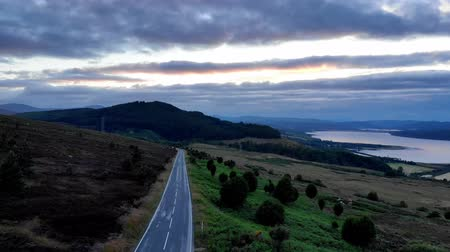 geologia : Flight over a lonesome road along Loch Shin in Scotland - evening view