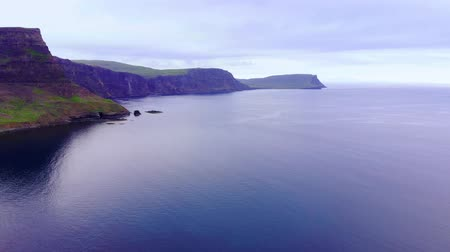 lakes of scotland : Neist Point on the Isle of Skye - amazing cliffs and landscape in the highlands of Scotland Stock Footage
