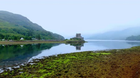 lakes of scotland : Flight over Loch Duich with Eilean Donan Castle in Scotland
