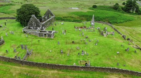 lakes of scotland : Ruins of an old church and cemetery in Scotland - aerial drone footage