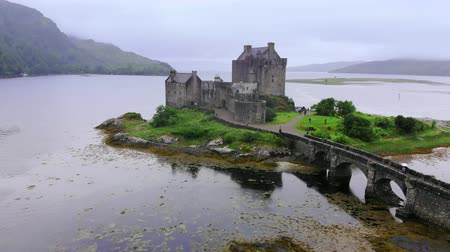 lakes of scotland : Flight around the famous Eilean Donan Castle at Loch Duich in Scotland Stock Footage