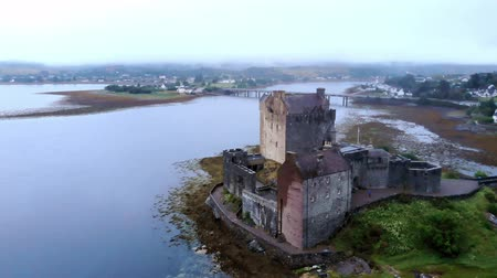 lakes of scotland : Flight over famous Eilean Donan Castle in the Highlands of Scotland - aerial drone footage