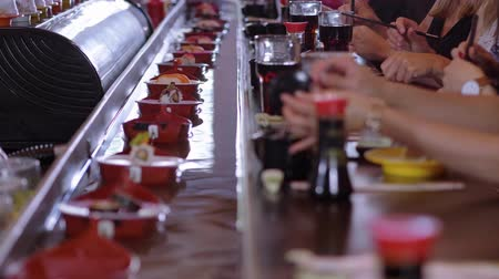 roll up : Running Sushi Bar - plates with freshly made sushi on boats