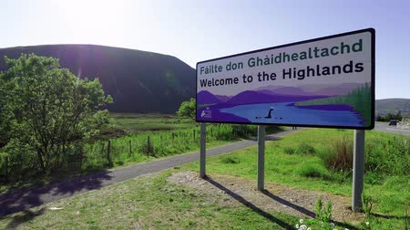 lakes of scotland : Welcome to the Highlands sign in Scotland Stock Footage