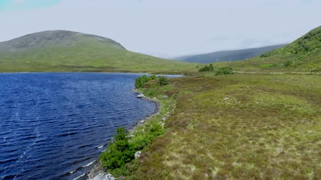 geologia : Flight over small lakes and creeks in the highlands of Scotland