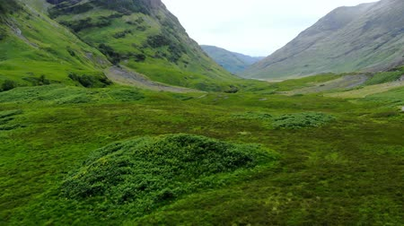 lakes of scotland : Glencoe valley in the highlands of Scotland - aerial drone footage Stock Footage