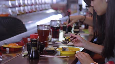 soy : People eating Sushi in a Running Sushi restaurant Stock Footage