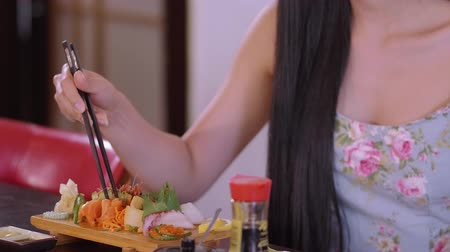 heathy : Young Asian girl eats Sushi