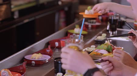 heathy : Eaiting freshly made Sushi at a Running Sushi Bar Stock Footage