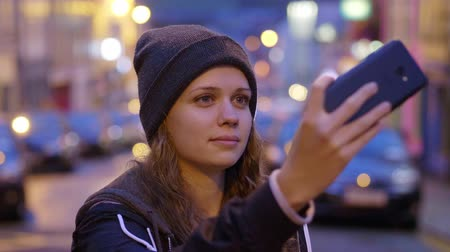 selfie girl : Beautiful woman takes a selfie with her mobile phone