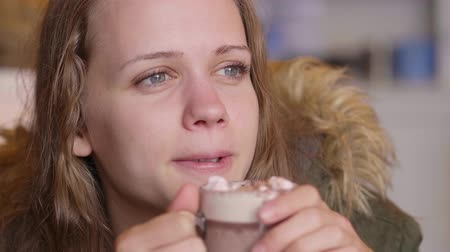 kerry : Close up shot of a young woman drinking hot chocolate Stock Footage