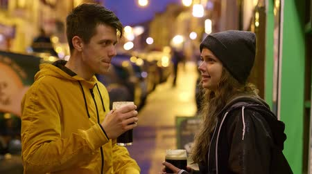 kerry : Two friends with a glass of beer in the streets of a small village