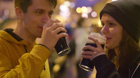 na zdraví : Two friends say cheers and drink beer in front of a pub