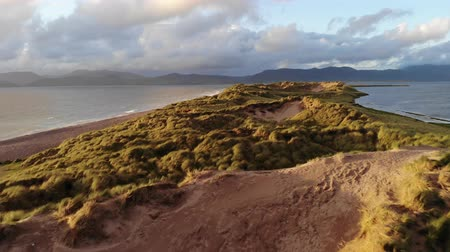 rocky mountains : Deep flight over the dunes at the Irish west coast Stock Footage