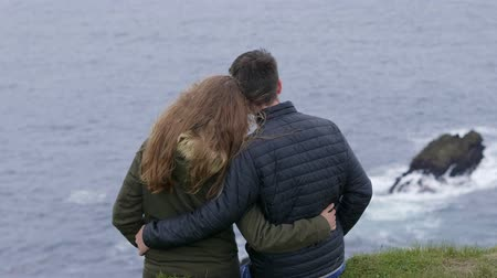 kerry : Happy scene of two friends in love looking over the ocean