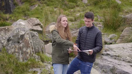kerry : Sightseeing trip through Ireland - two friends checking the map