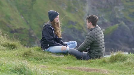 przyjaźń : Young couple in love relax in the hills of the Irish west coast Wideo