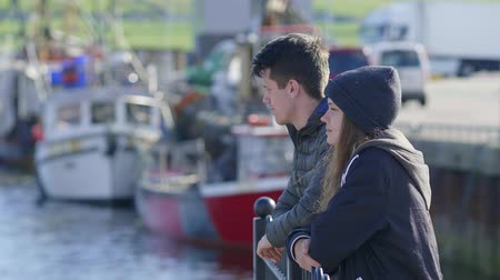 kerry : Two friends enjoy the relaxing time at the harbor