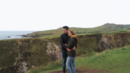kerry : Flight around a couple in love standing at the edge of a cliff