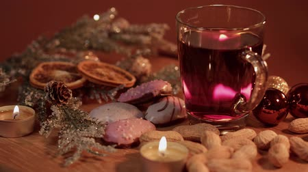 изюм : Beautiful Christmas plate with mulled wine and peanuts