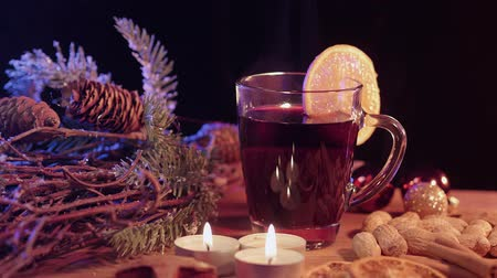 anos : Beautiful Christmas decoration on a table with mulled wine Archivo de Video