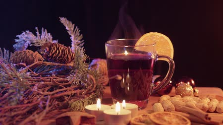 adwent : Beautiful Christmas decoration on a table with mulled wine Wideo