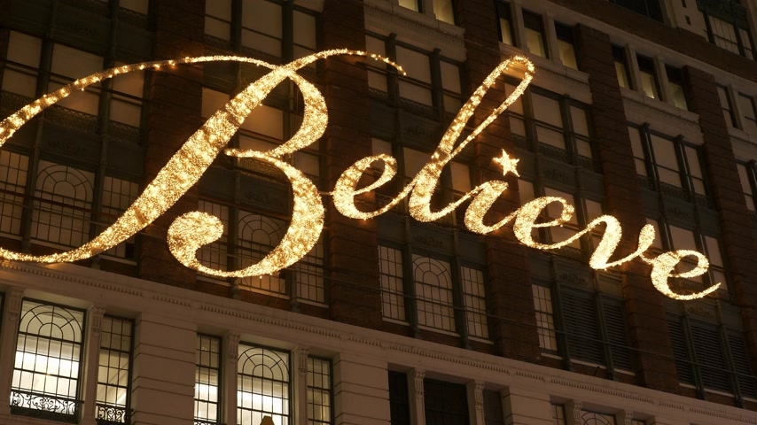 apple park : Believe writing on the house facade of famous Macys department store in Manhattan