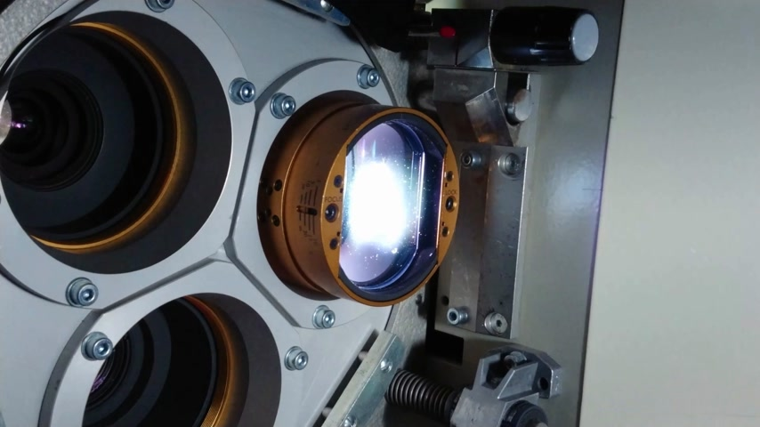 cinematography : Close up of a 35mm cinema projector in a movie theater