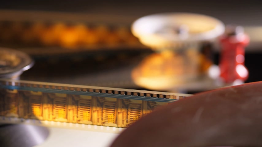 filmmaker : Film runs through a 35mm projector in a movie theater Stock Footage
