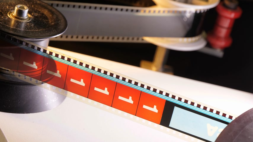 fascination : The fascination of cinema - 35mm film projected in a movie theater Stock Footage