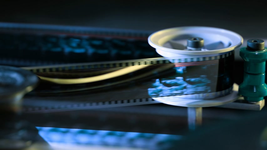 spool : Film runs through a 35mm projector in a movie theater Stock Footage