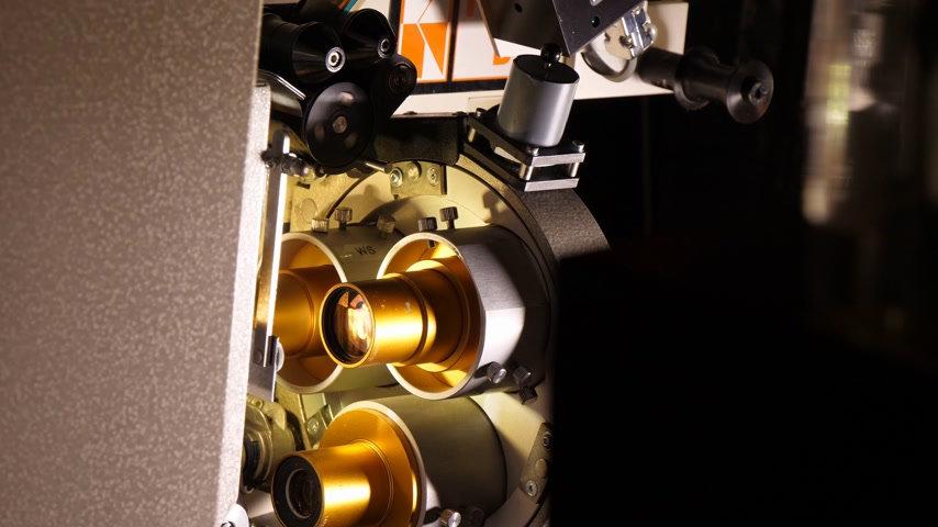 メカニカル : Film runs through a 35mm projector in a movie theater 動画素材