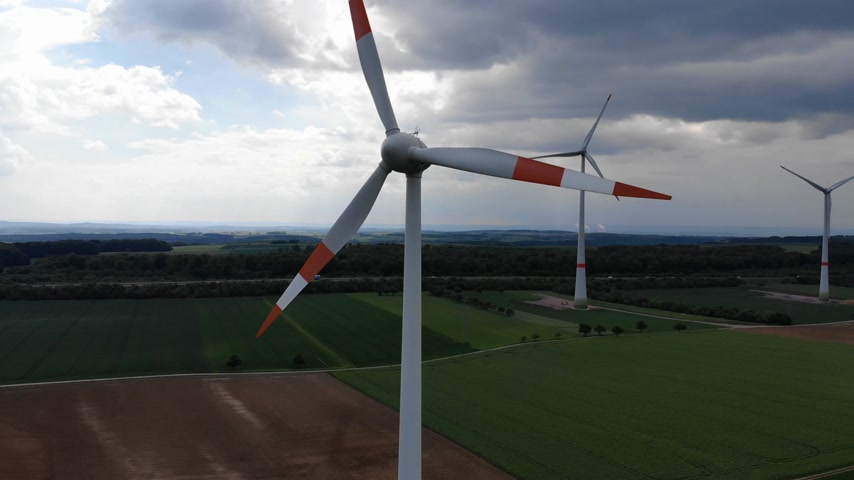 clean electricity production : Wind energy plant - modern wind power station on a hill - clean energy