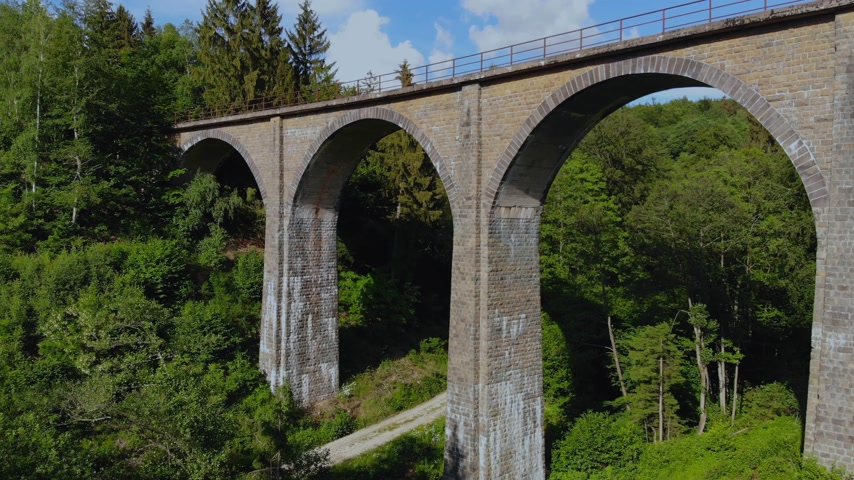 canola : Railway overpass in the forest hills - aerial view over an old viaduct Stock Footage