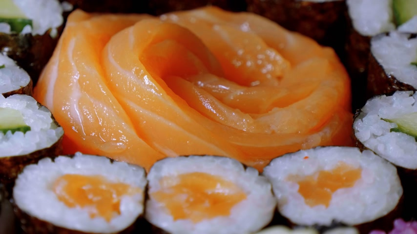 roll up : Salmon Sashimi Sushi and a maki selection Stock Footage