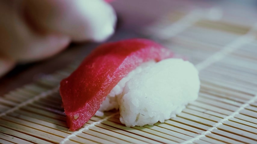 sushibar : Preparing Tuna nigiri sushi - fresh tuna fish over rice