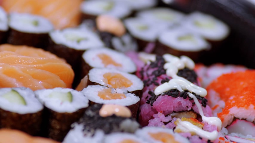 sushibar : Fresh Sushi rolls- close up shot Stock Footage