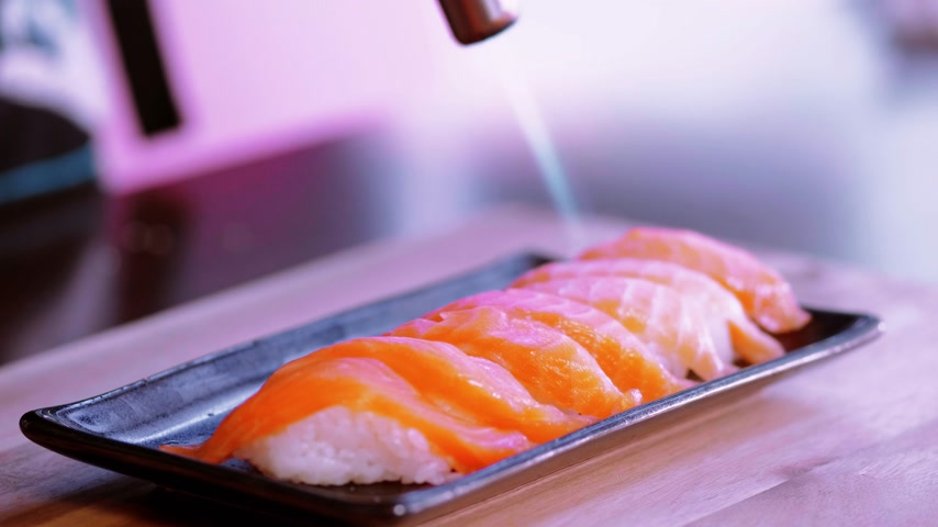 heathy : Perparing grilled Salmon Sushi with a hot flame Stock Footage
