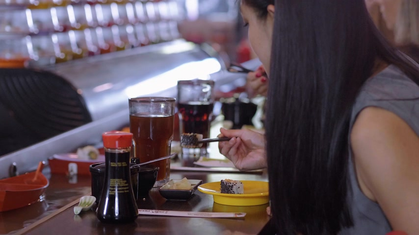heathy : People eating Sushi in a Running Sushi restaurant Stock Footage
