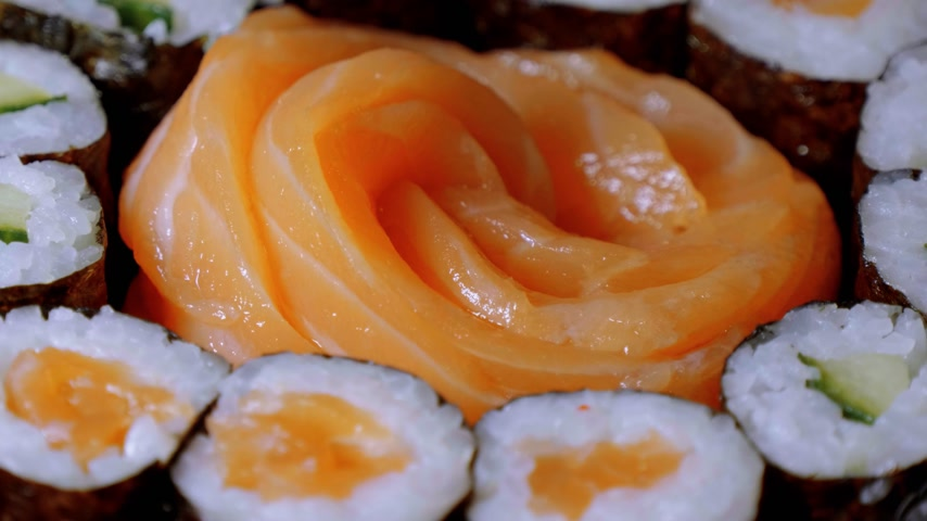 roll up : Sake Sashimi - fresh raw Salmon served in a Sushi Bar