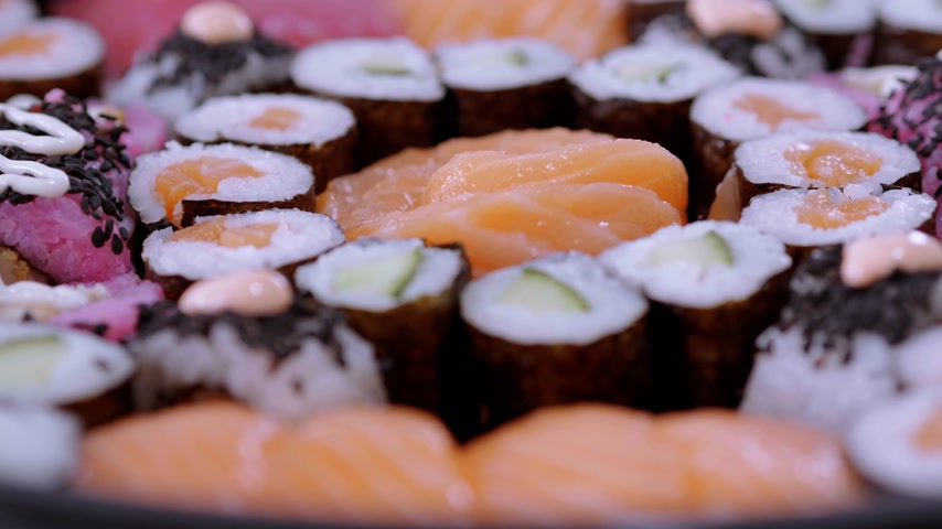 heathy : Typical Asian food - Variety of different Sushi pieces on big plate