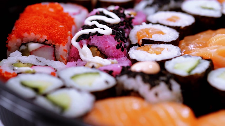 roll up : Selection of freshly made Sushi pieces on a plate
