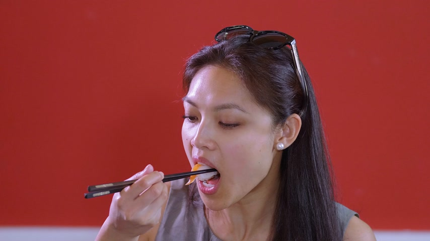 soy : Asian woman eats Sushi - close up shot