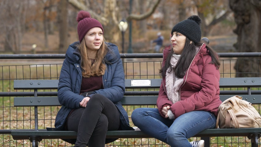 apple park : Young women enjoy their relaxing time at Central Park New York